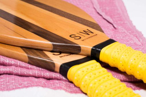 Frescobol Set by Salt on Wood in yellow